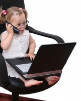 toddler with phone and laptop