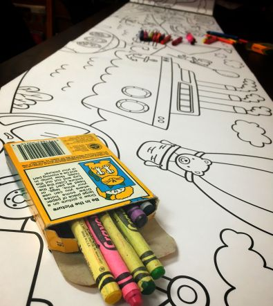 Photo of 10 foot coloring sheet roll with crayons