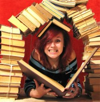 teen under pile of books