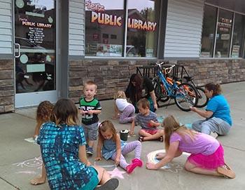Sidewalk chalk at Pierz Public Library